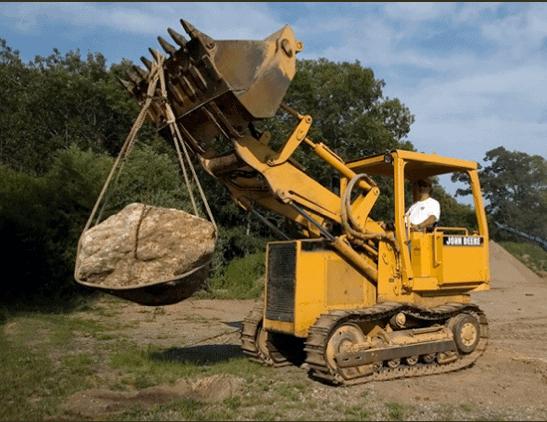 john deere lifting boulder
