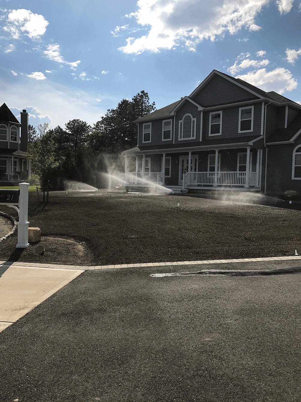 sprinklers on soil in lawn